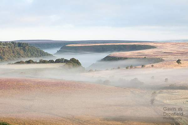North Dale cutting into misty North York moors plateau at dawn