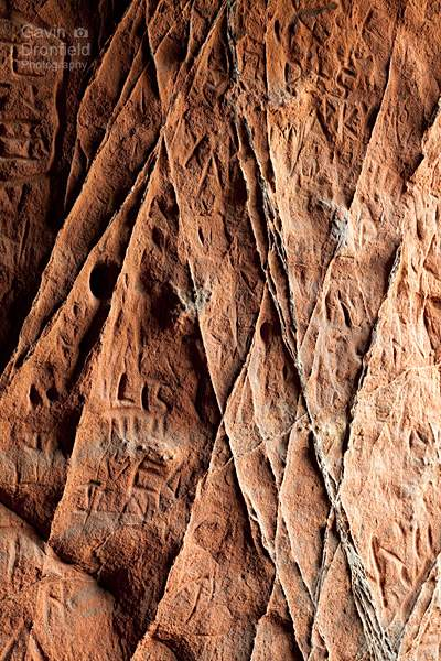 carved patterns in sandstone inside Lacys Caves