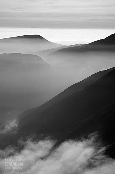 monochrome Seatallan Yewbarrow Kirk Fell rise out of mist
