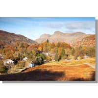 Elterwater village and Langdale Pikes at dawn in autumn
