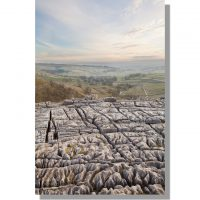 pastel sunset over Malhamdale from top of Malham Cove