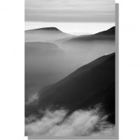Monochrome Seatallan Yewbarrow Kirk Fell rise out of mist