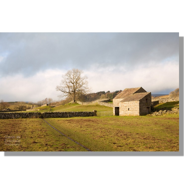 Hardraw barn adjacent to Pennine Way footpath in winter fields