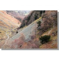 broadslack gill and the allerdale ramble path pass behind castle crags scree in winter