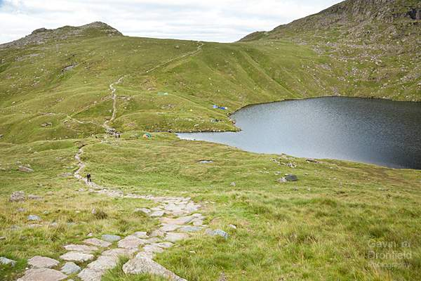 angle tarn surrounded by wild campers tents at the head of angletarn gill