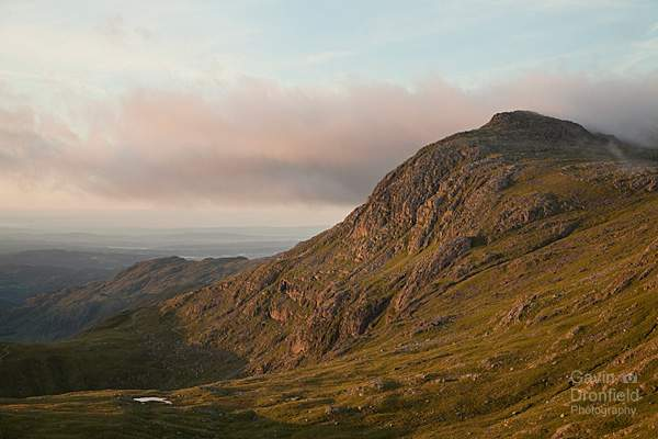 bow fell turning red in warm dawn light seen from allen crags