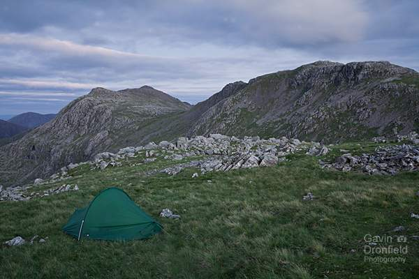 bow fell, ore gap and esk pike from terra nova tent on allen crags in twilight