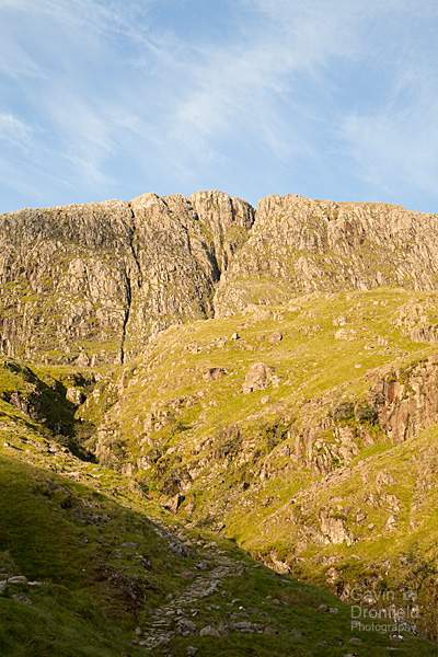 great end crag at the head of ruddy gill ravine under blue skies