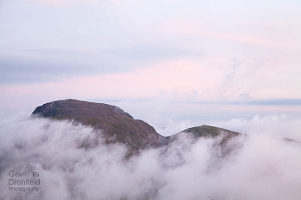 great gable and green gable summits separated by windy gap above swirling cloud under pink dawn skies