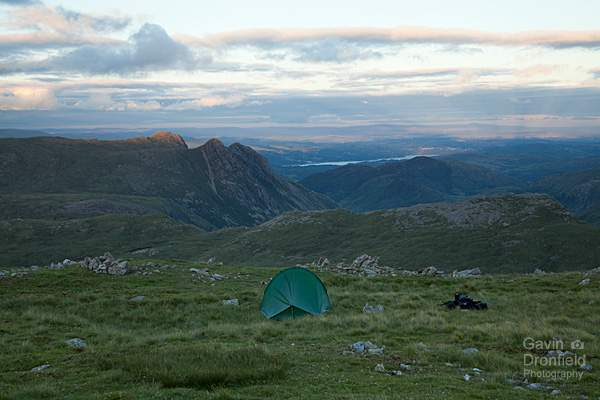 distant windermere and langdale pikes from terra nova tent on allen crags in twilight