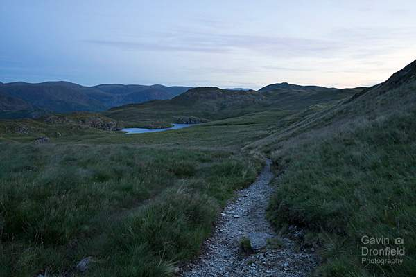 footpath from brock crags to angle tarn and angletarn pikes in pre-dawn blue light