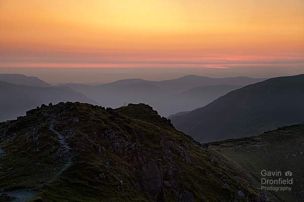 red orange atmospheric summer sunset from dale head ridge path looking over loweswater fells