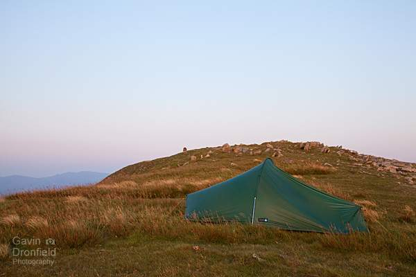 tent pitched on dale head summit ridge at red summer dusk
