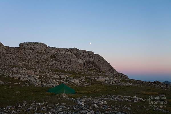moonlit terra nova explorer tent pitched under esk pike summit crag