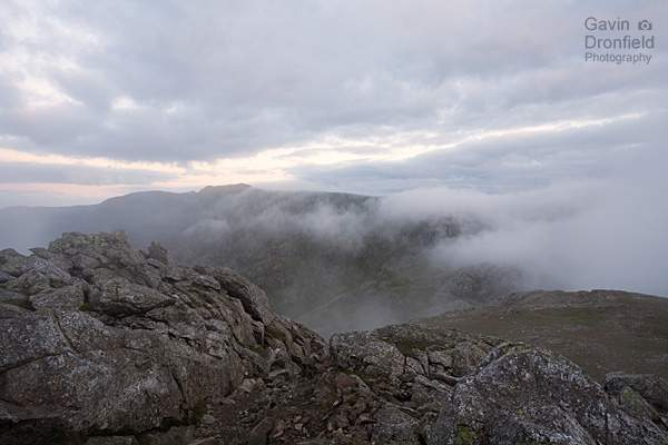 scafell pike summit in cloud across head of eskdale from esk pike summit