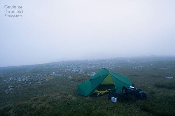 wil camping in a terra nova explorer tent in mist on esk pike