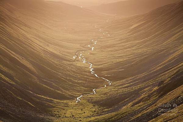 high cupgill beck meandering down u-shaped high cup gill valley from high cup nick during golden winter sunset