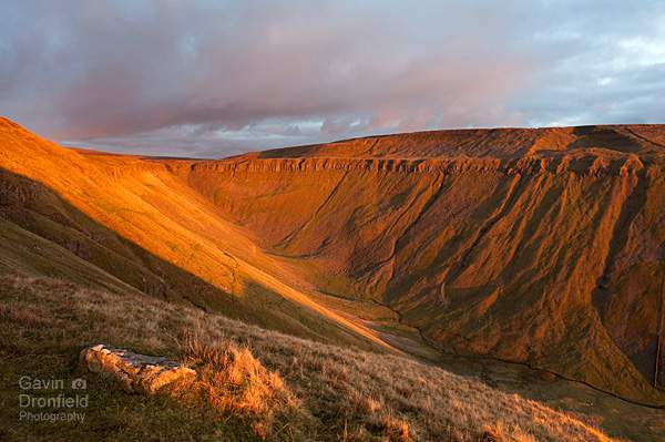 high cup nick golden sunset and the high cup gill valley seen from the pennine way path
