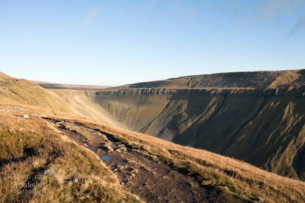 high cup nick at the head of the high cup gill valley on bright winter day from the pennine way path