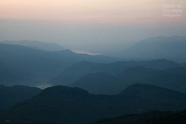 atmospheric blue and orange dusk over borrowdale fells of sargeants crag, heron crag, grange fell, catbells and skiddaw
