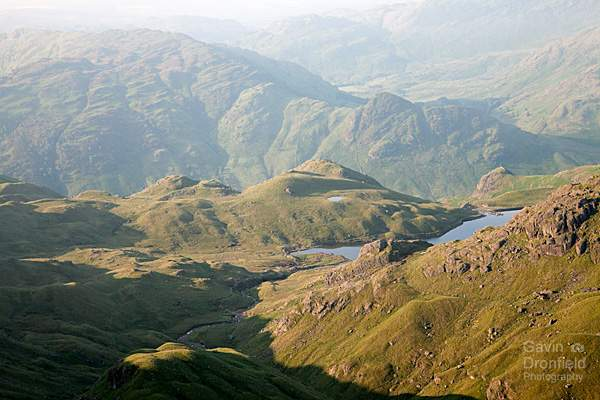 Sergeant Man view of stickle tarn, side pike and great langdale on a bright summer's morning