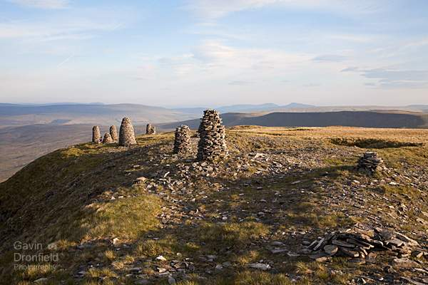 stone men on wild boar fell at sunset in summer 2018