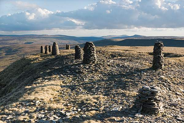 stone men on wild boar fell at sunset in spring 2012