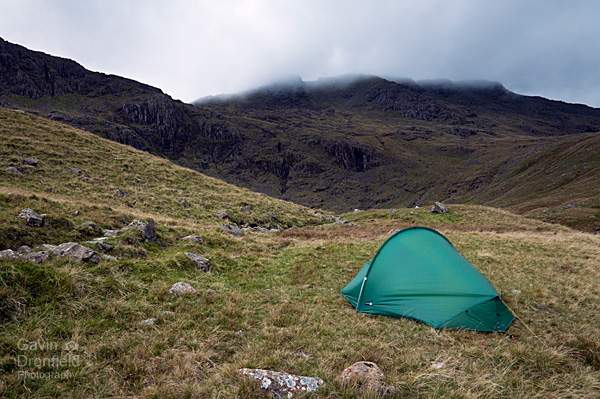 terra nova competition tent pitched near angle tarn under cloud covered esk pike