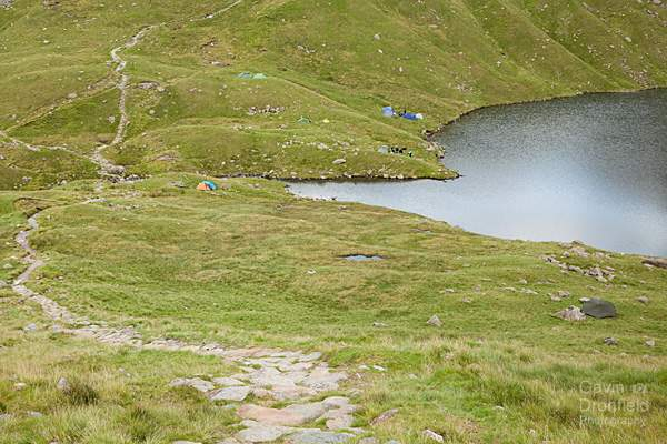 wild campers tents camped on the shore of angle tarn at the head of angletarn gill