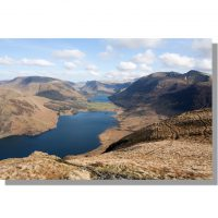Crummock Water and Buttermere lakes surrounded by fells from south summit of Mellbreak under blue winter skies