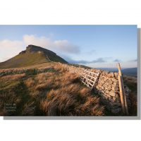 Pen-y-ghent dry stone wall in moody spring sunset