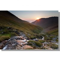 Atmospheric sunset over Liza Beck tumbling down Gasgale Gill from Coledale Hause