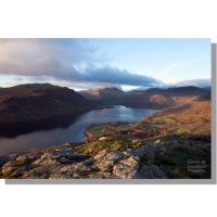 Gowbarrow Fell sunrise over autumnal Ullswater