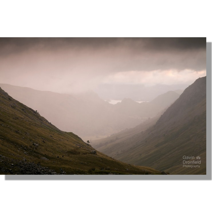 rain and dark moody skies over grains valley and borrowdale