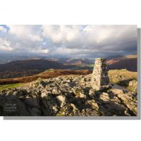 Loughrigg Fell trig point view of Easedale under cloudy skies