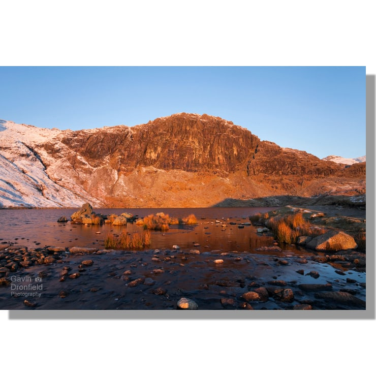 Pavey Ark and Stickle Tarn at dawn in winter