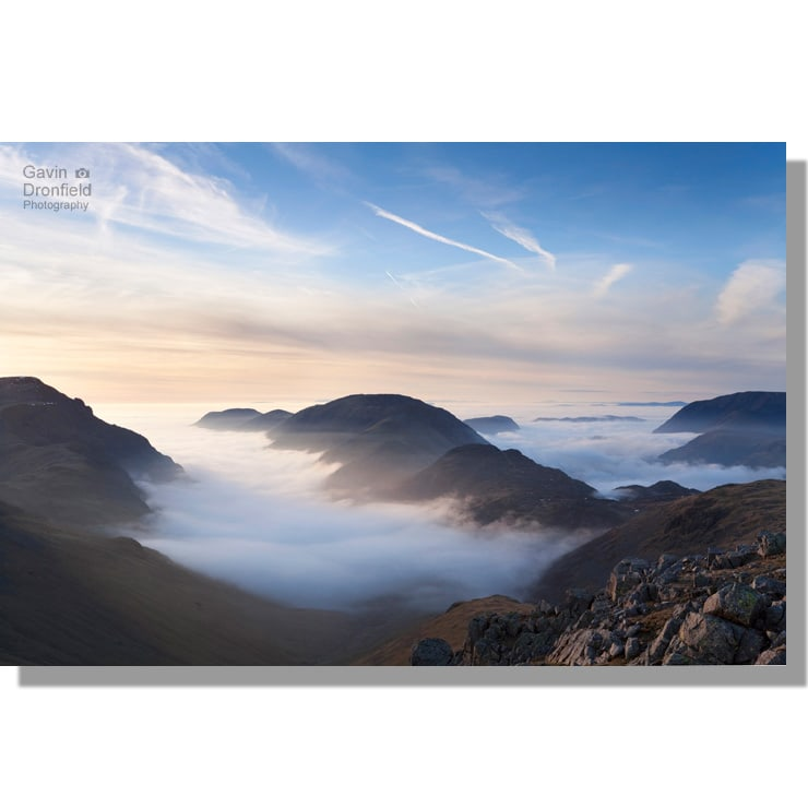 High Stile ridge rising above fog enshrouded Ennerdale and Buttermere valleys seen from Green Gable at sunset
