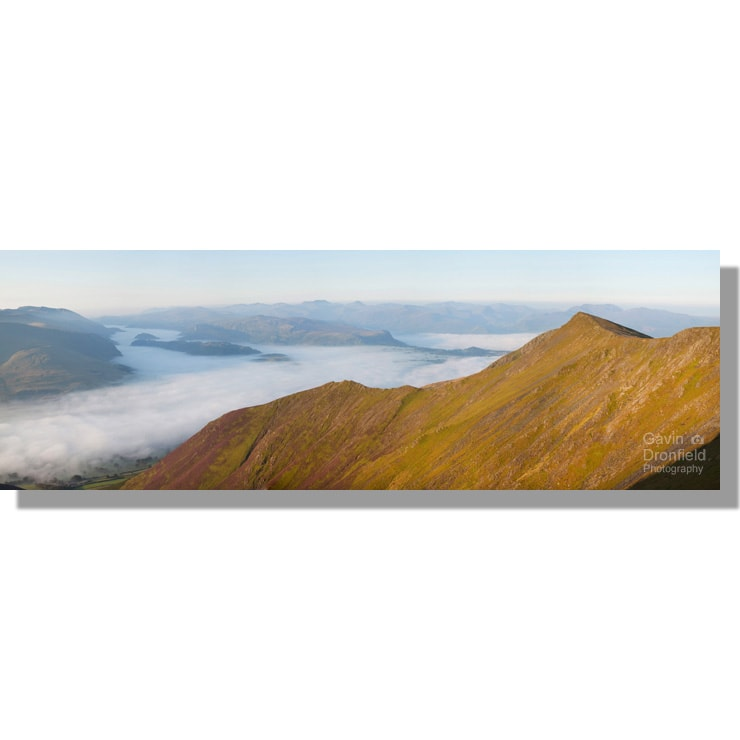 Gategill Fell ridge dawn panorama above cloud inversion in Glenderaterra valley and St. john's in the Vale