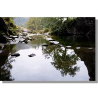 reflection in Rydal Cave pool with stepping stones