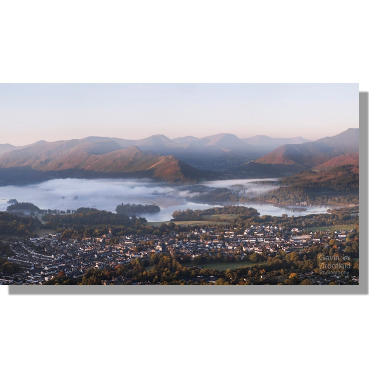 Autumnal dawn mists over Keswick and Derwent Water from Latrigg