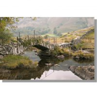 Slater Bridge over autumnal River Brathay in Little Langdale