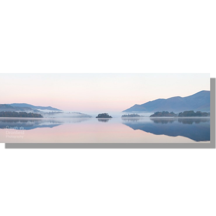 islands of Derwent Water panorama during misty pastel sunrise