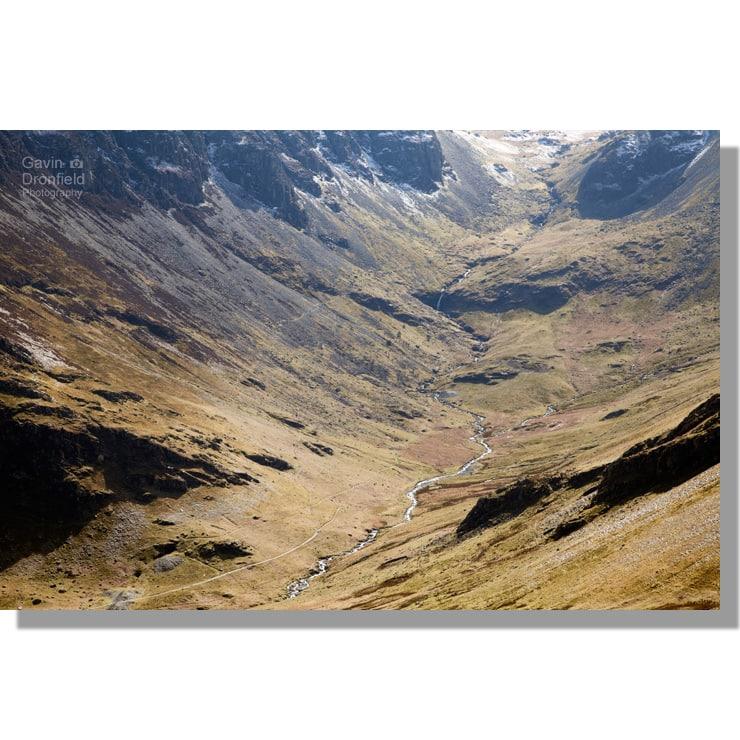 Newlands Beck flows under High Spy crags