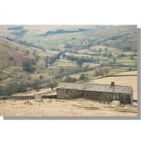 remote kisdon farm barn view of wintery swaledale