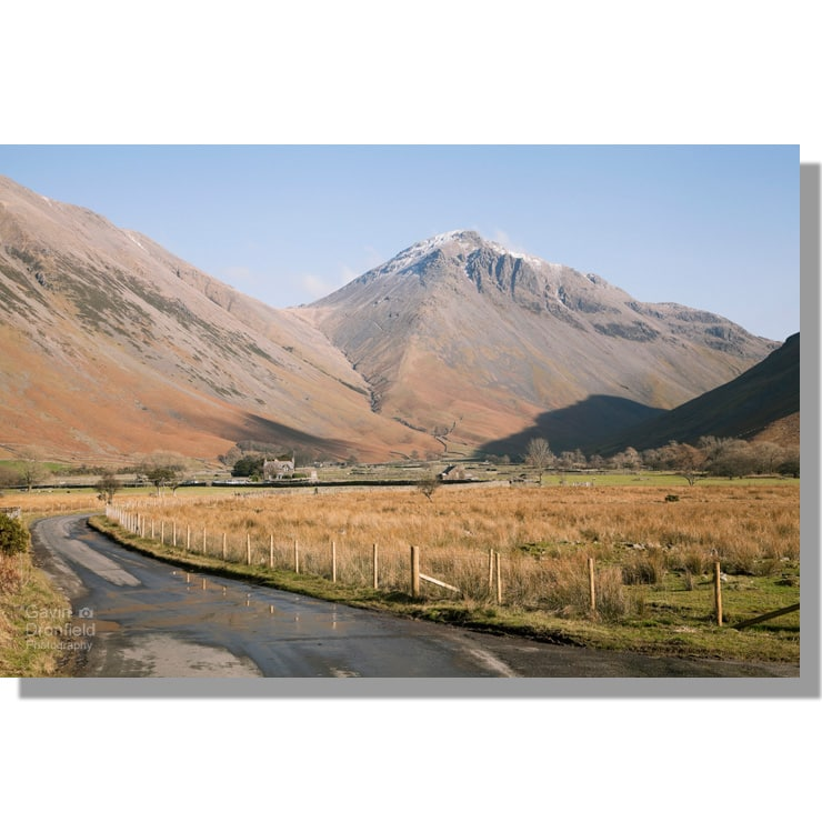 road to wasdale head under snow-capped great gable