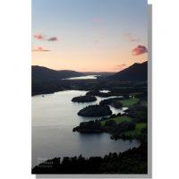 Falcon Crag view of Derwent Water and Bassenthwaite Lake during orange sunset