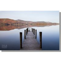 colourful derwent water reflections from ashness jetty in autumn