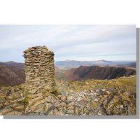 Dale Head summit cairn overlooking newlands valley, high spy, maiden moor