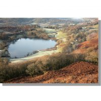 Colourful loughrigg tarn from ivy crag on loughrigg fell in winter