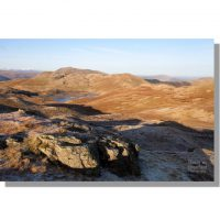 angle tarn and angletarn pikes bathed in winter light from brock crags